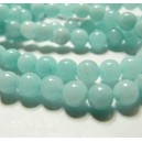 1 fil de perles  jade teintée couleur bleu pale 4mm environ 97 perles