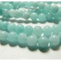 1 fil de perles jade teintée couleur bleu pale 6mm environ 61 perles
