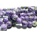 1 fil d'environ 66 perles pierres teintées vert violet 6mm
